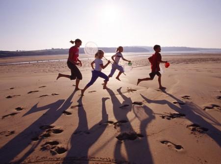 Children running on the beach