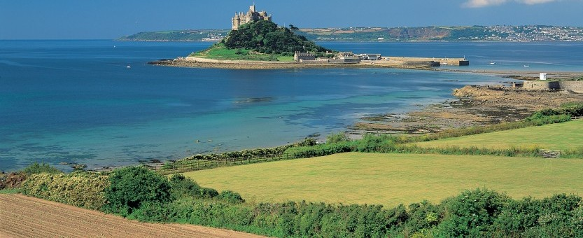 ploughing fields in the shadow of St Michaels Mount